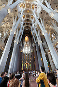 tourists looking up towards the ceiling Sagrada Familia Barcelona Spain