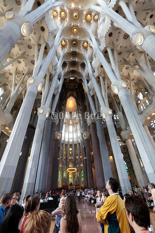 tourists looking up towards the ceiling Sagrada Familia Barcelona Spain