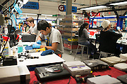 Employees refurbish classic Nintendo, Sega, Playstation and Dreamcast consoles at the GameStop retro classics console games refurbishment center in Grapevine, Texas on June 24, 2015. (Cooper Neill for Mashable)