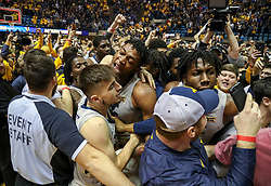 Jan 19, 2019; Morgantown, WV, USA; West Virginia Mountaineers players celebrate after beating the Kansas Jayhawks at WVU Coliseum. Mandatory Credit: Ben Queen-USA TODAY Sports