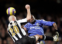 Photo: Marc Atkins.<br /> Chelsea v Newcastle United. The Barclays Premiership. 13/12/2006. Antoine Sibierski of Newcastle in action with Geremi of Chelsea.