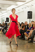 Flowing red dress with cap sleeves and dip hem. By Carmen Marc Valvo at the Spring 2013 Fashion Week show in New York.