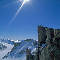 Expedition members exult after the first ascent of the north face of Great Sail Peak, an arctic big wall climb on Canada's Baffin Island.