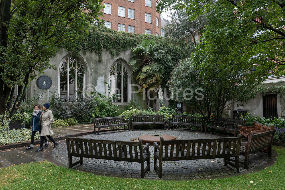 Two woman walking through St Dunstan's in the East on the 20th September 2019 in London in the United Kingdom. St Dunstan's in the East was a Church of England parish church on St Dunstans Hill. The church was largely destroyed in the Second World War and the ruins are now a public garden.