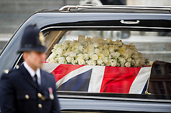 © London News Pictures.17/04/2013. London, UK.  The coffin of Margaret Thatcher  leaving St Paul's Cathedral in London following the funeral of former British Prime Minister Margaret Thatcher on April 17, 2013. Photo credit : Ben Cawthra/LNP
