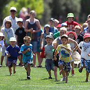 Children compete in a running race during the 50th Anniversary Glenorchy Race meeting. The races, which originally started in the 1920's, were resurrected in 1962 and have been run by local farmers and the rugby club on the first Saturday after New Years Day ever since. Glenorchy, Otago, New Zealand. 7th January 2012