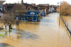 © Licensed to London News Pictures. 25/02/2020. Shrewsbury, Shropshire, UK. River Severn levels continue to rise at Shrewsbury in Shropshire, UK causing severe flood disaster situation. The Environment Agency forecast levels to peak soon. The level at 12.45 hrs at Welsh Bridge was 5.07 metres. Photo credit: Graham M. Lawrence/LNP