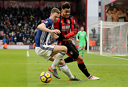 West Bromwich Albion's Chris Brunt (left) and AFC Bournemouth's Joshua King (right) battle for the ball during the Premier League match at the Vitality Stadium, Bournemouth.