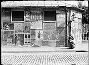 street posters on Rue de Grenelle, Paris France around 1900