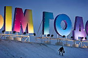 Moscow, Russia, 07/01/2006..Russians celebrate the lengthy New Year and Orthodox Christmas holidays. Illuminated Happy New Year sign and ice sculptures at Poklonnnaya Gora park.