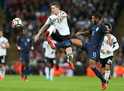 10 November 2017 - International Football Friendly - England v Germany - Joseph Gomez of England stretches to intercept Julian Draxler of Germany - Photo: Charlotte Wilson / Offside