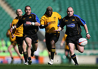 Photo: Jonathan Butler.<br /> <br /> Northwich v Bradford Salem. EDF Energy Senior Vase Final. 15/04/2007. Northwichs Dave Khanyile chases down a ball flanked by Sean Thomas (l) and Richard Langhron (r)