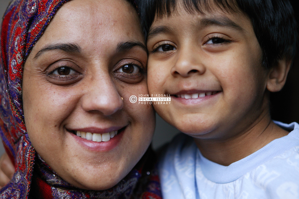 Close up of single parent and her young son smiling,
