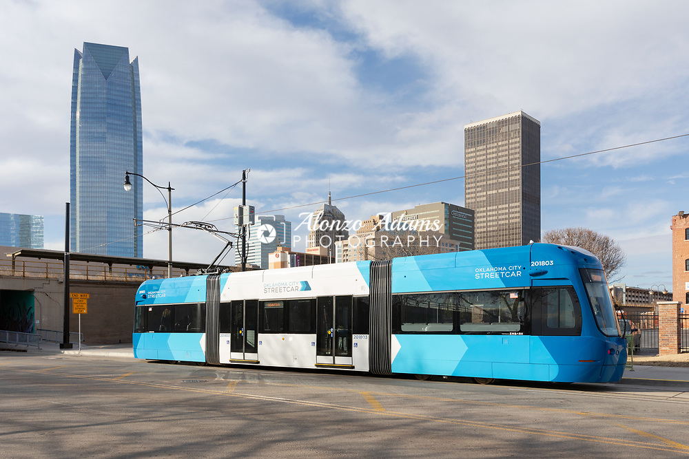 The blue Oklahoma City Streetcar in Bricktown district of Oklahoma City. Photo copyright © 2019 Alonzo J. Adams