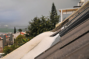 hail collects in a gutter after a hail storm, Photographed in Haifa, Israel in March