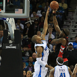 06 February 2009:  Toronto Raptors center Jermaine O'Neal (6) shoots over the defense of New Orleans Hornets forward David West (30) during a 101-92 win by the New Orleans Hornets over the Toronto Raptors at the New Orleans Arena in New Orleans, LA.