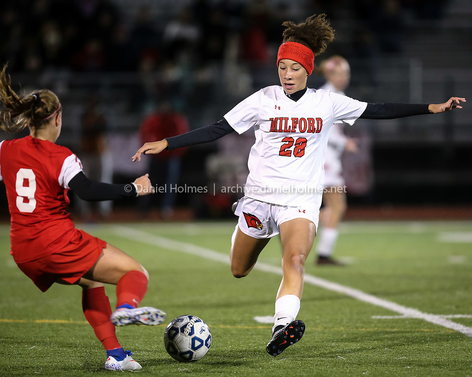 (10/31/16, MILFORD, MA) Milford's Ashleigh Starks steals the ball from Holliston's Sidney Brucato during the girls soccer game against Holliston at Milford High School on Monday. Daily News and Wicked Local Photo/Dan Holmes