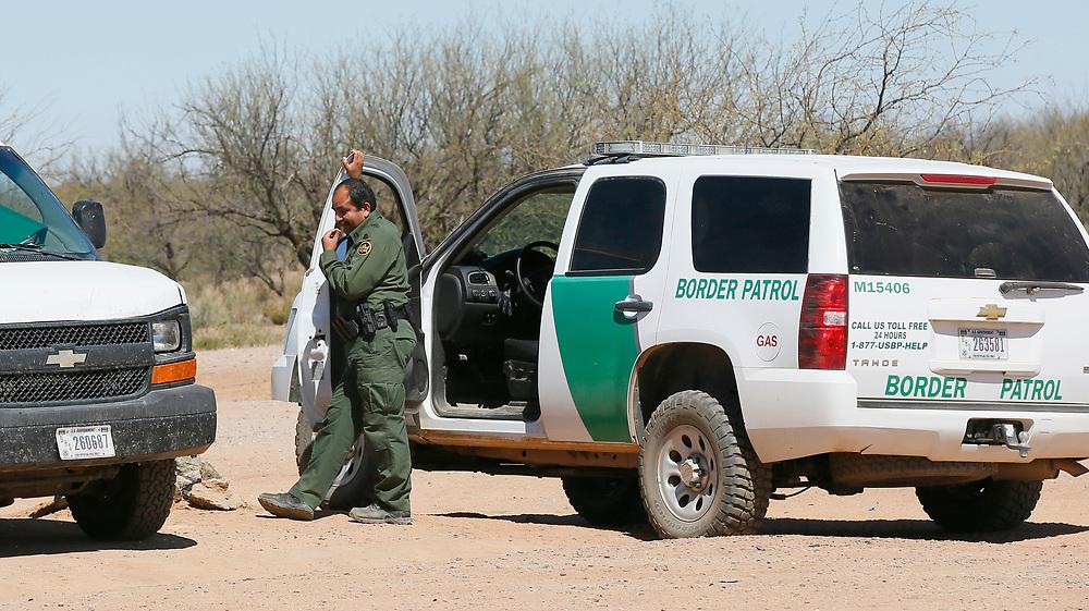 U.S. Customs and Border Protection agents talk near the U.S. - Mexico border that crosses the Tohono O'odham reservation in Chukut Kuk, Arizona April 6, 2017. Picture taken April 6, 2017.  REUTERS/Rick Wilking