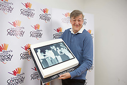 Stephen Fry, winner of the 1981 Edinburgh Comedy Award, with a birthday cake presented to him at this year's ceremony. pic Terry Murden @edinburghelitemedia