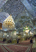 Stunning photographs reveal the beautiful ceilings in Iran's mosques, bazaars and public baths<br /> <br /> For the past few decades, restrictions on travel to Iran has meant the country has been largely shut off from the Western world, butas visa sanctions are lifted in the light of a landmark nuclear deal, the local tourism industry is hoping for a flurry of visitors.<br /> It's not hard to see why Iran is listed as one of the top travel destinations of 2016, with its rich culture and history.<br /> Among the standout aspects of the nation is its beautiful ancient architecture, with the cities and towns littered withornate and eye-catching mosques, public baths and markets.<br /> And unlike many other countries - the roof is not an afterthought, with many ceilings built as the centrepiece to the building, with many of the tile designs showcasing a display of intricate geometric patternsthatdate back several centuries.<br /> French photographerEric Lafforgue has travelled the country photographing the ceilings of indoor markets, mosques and bath houses.<br /> <br /> Photo shows: The Muslim Shiite People Hall Of The Shah-e-cheragh Mausoleum in Shiraz. Shah-e-Cheragh is a funerary monument and mosque where the tomb of Amir Ahmad and his brother Mir Muhammad, sons of the seventh Imam and brothers of Imam Reza, lie.