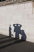"Two buskers are questioned by a police officer, their shadows played on a stone wall in Trafalgar Square.<br /> <br /> The diabolo (commonly misspelled as diablo; formerly also known as ""the devil on two sticks"") is a juggling prop consisting of a spool which is whirled and tossed on a string tied to two sticks held one in each hand. A huge variety of tricks are possible using the sticks, string, and various body parts."