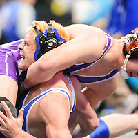 022213  Adron Gardner/Independent<br /> <br /> One hundred-seventy pound Miyamura Patriot wrestler Zac Canning, right, gets Los Lunas Tiger Tristin Rasp in a choke hold during the Championship at the Santa Ana Star Center in Rio Rancho Friday.  Canning won the match to advance in the tournament.
