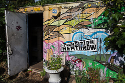 Sipson, UK. 5th June, 2018. A painted Transition Heathrow mural is pictured at Grow Heathrow. Grow Heathrow is a squatted off-grid eco-community garden founded in 2010 on a previously derelict site close to Heathrow airport to rally support against government plans for a third runway and it has since made a significant educational and spiritual contribution to life in the Heathrow villages, which remain threatened by Heathrow airport expansion.