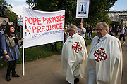 Protesters gather in Hyde Park to voice opposition to Catholic thinking during Pope Benedict XVI's papal tour of Britain 2010, the first visit by a pontiff since 1982. Taxpayers footed the £10m bill for non-religious elements, which largely angered a nation still reeling from the financial crisis. Pope Benedict XVI is the head of the biggest Christian denomination in the world, some one billion Roman Catholics, or one in six people. In Britain there are about five million Catholics but only a quarter of Catholics regularly attend Sunday Mass and some churches have closed owing to spending cuts.