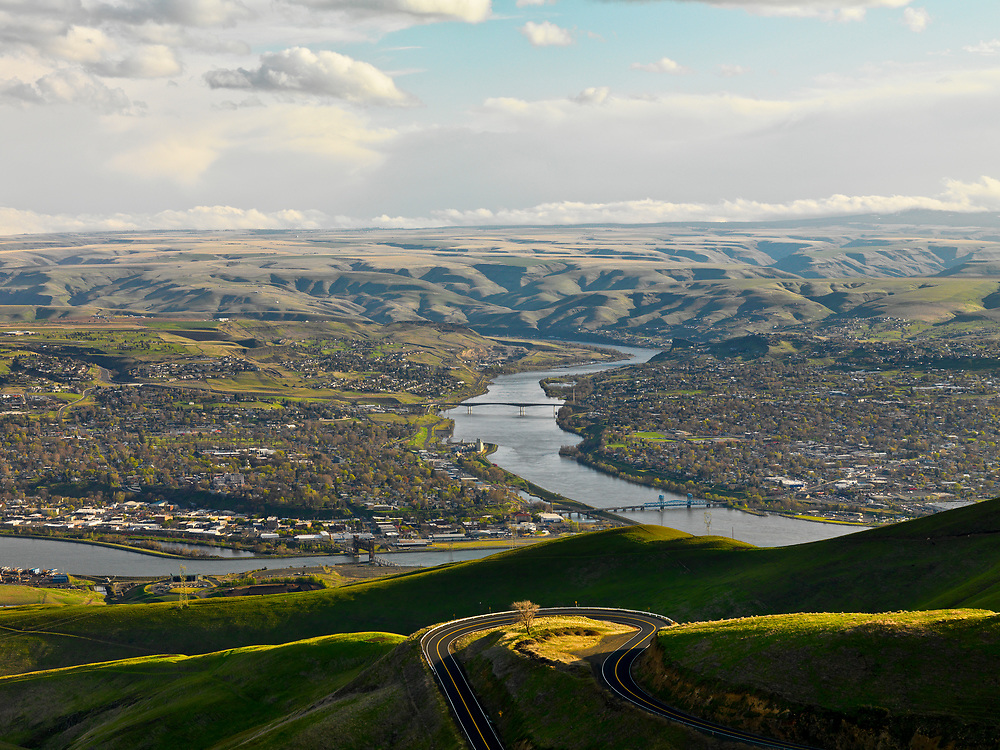 High vista view of the Lewiston Idaho on left and Clarkston Washington on the Right separated by the Snake River with the Clearwater River converging on bottom left of frame in Springtime.  Licensing and Open Edition Prints.