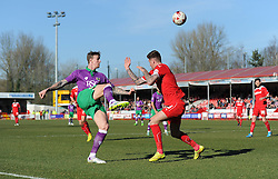 Bristol City's Aden Flint lifts the ball over the top of Crawley's Sonny Bradley - Photo mandatory by-line: Dougie Allward/JMP - Mobile: 07966 386802 - 07/03/2015 - SPORT - Football - Crawley - Broadfield Stadium - Crawley Town v Bristol City - Sky Bet League One