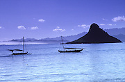 Outrigger canoes at Chinaman's Hat, Kualoa, Oahu, Hawaii<br />