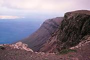 Steep coastal cliffs Risco de Famara looking north towards Graciosa island, Lanzarote, Canary Islands, Spain