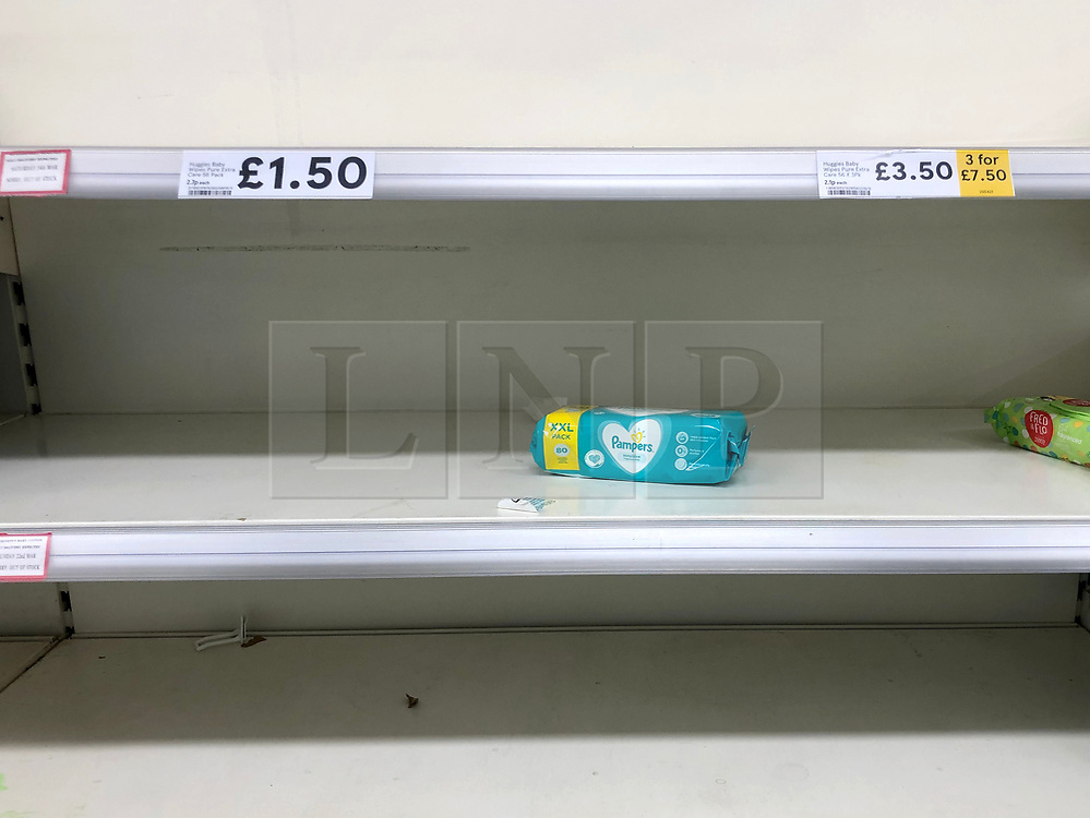 © Licensed to London News Pictures. 13/03/2020. Leeds UK. TESCO LEEDS. Empty Baby Wipe shelves at Tesco in the Seacroft area of Leeds this morning as people continue to panic buy in fear of quarantine measures and shortages as the current Coronavirus ( COVID-19 ) spread starts to impact more people. Photo credit: Andrew McCaren/LNP