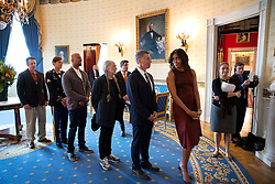 """First Lady Michelle Obama looks back at workshop participants Robert Santelli, Executive Director of The GRAMMY Museum, Willie Nelson, Common, U.S. Army Sergeant Christiana Ball and U.S. Navy veteran Ted Peterson in the Blue Room, prior to """"The Stars and Stripes Forever: A History of Music and the Military""""  workshop in the East Room of the White House, Nov. 6, 2016. (Official White House Photo by Chuck Kennedy)<br /> <br /> This official White House photograph is being made available only for publication by news organizations and/or for personal use printing by the subject(s) of the photograph. The photograph may not be manipulated in any way and may not be used in commercial or political materials, advertisements, emails, products, promotions that in any way suggests approval or endorsement of the President, the First Family, or the White House."""
