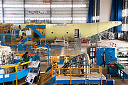 Employees work on the assembly line of the C-27J Spartan aircraft at the Alenia Aeronautica plant at Capodichino, in Naples, Italy, on Monday, Sept. 6, 2010.