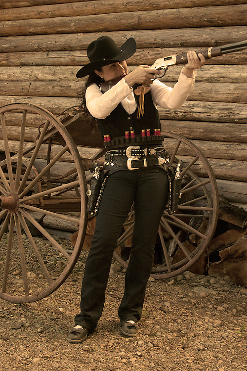 Sepia Photograph Cowgirl Aiming her Rifle
