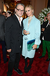 DAVID DOWNTON and LAURA BAILEY at a private view of fashion art by David Downton as in-house artist at Caridge's , held at Claridge's Hotel, London on 13th September 2013.