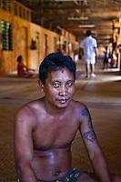 Iban man with tattoos in Nanga Sumpa Longhouse