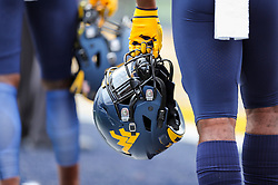 Sep 22, 2018; Morgantown, WV, USA; A West Virginia Mountaineers player holds his helmet during warmups before their game against the Kansas State Wildcats at Mountaineer Field at Milan Puskar Stadium. Mandatory Credit: Ben Queen-USA TODAY Sports