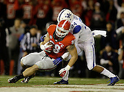 ATHENS, GA - NOVEMBER 23:  Tight end Arthur Lynch #88 of the Georgia Bulldogs pulls in a touchdown pass behind defensive back Blake McClain #24 of the Kentucky Wildcats during the second quarter of the game at Sanford Stadium on November 23, 2013 in Athens, Georgia.  (Photo by Mike Zarrilli/Getty Images)