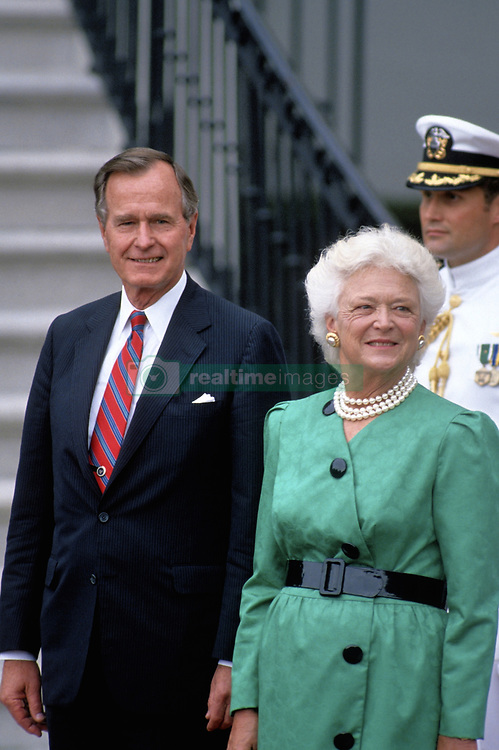 Former first lady Barbara Bush, wife of former President George H.W. Bush and mother of former President George W. Bush, died Tuesday at her home in Houston. She was 92. Bush had been in failing health, suffering from congestive heart failure and chronic obstructive pulmonary disease. George and Barbara, who celebrated their 73rd wedding anniversary on Jan. 6, hold the record for the longest-married presidential pair. Barbara Bush, was known for her wit and emphasis on family. One of her primary causes was literacy and she founded the  Barbara Bush Foundation for Family Literacy in 1989. PICTURED: 1989 - Washington, District of Columbia, United States of America - Washington, DC. President GEORGE H.W. BUSH and First Lady Barbara Bush stand at the South Portico of the White House awaiting the arrival of Diplomatic guest. (Credit Image: © Mark Reinstein via ZUMA Wire)