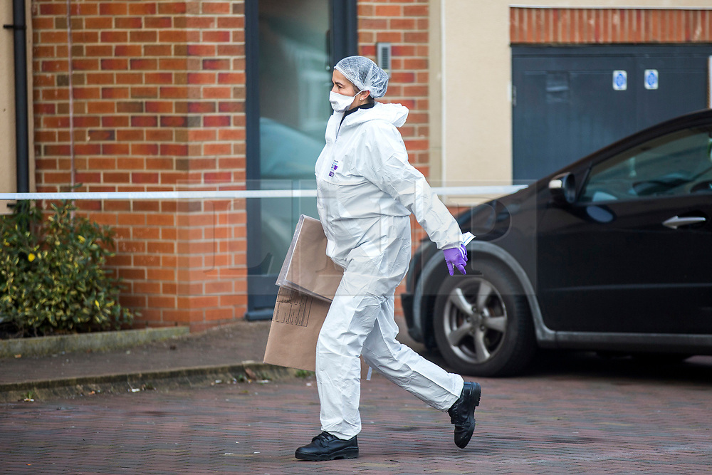 © Licensed to London News Pictures. 13/02/2019. Leeds UK. Police forensic officer at the scene on Athlone Grove in Leeds this morning after the body of a woman was found inside a block of flats. A man has been arrested on suspicion of murder after he fell from a bridge over the A64 in Leeds. Photo credit: Andrew McCaren/LNP