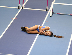 March 2, 2018 - Birmingham, United Kingdom - Elisavet Pesiridou (Greece) lies on the track in pain after falling hard during the IAAF World Indoor Championships women's 60m hurdles. (Credit Image: © Hurdles-7.jpg/SOPA Images via ZUMA Wire)