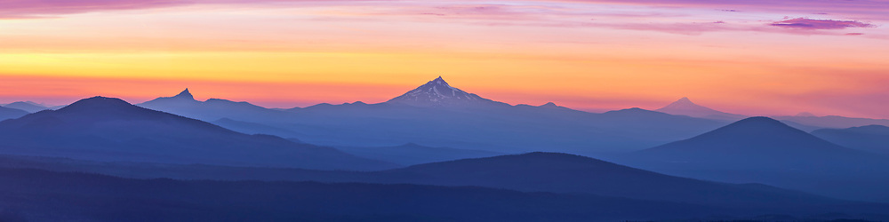 A watercolor sunset including some of the major peaks of the Cascade range in Central Oregon. Mt Washington, Mt Jefferson, Black Butte, Mt hood, and Mt Adams in Washington State