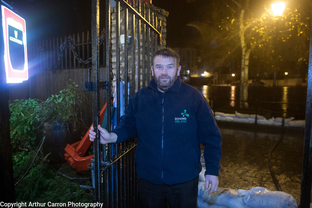 9/12/15 Paul O'Donovan protects his premises at Sean's Bar as the river Shannon bursts its banks causing flooding in Athlone town. Picture: Arthur Carron