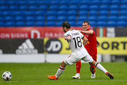 Connor Roberts of Wales is challenged by Galin Ivanov of Bulgaria - Rogan/JMP - 06/09/2020 - FOOTBALL - Cardiff City Stadium - Cardiff, Wales - Wales v Bulgaria - UEFA Nations League Group B4.