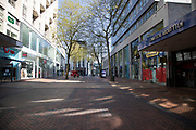 Birmingham city centre eerily quiet and deserted on New Street, one of the normally busy shopping areas, under lockdown due to Coronavirus on 24th April 2020 in Birmingham, England, United Kingdom. Coronavirus or Covid-19 is a new respiratory illness that has not previously been seen in humans. While much or Europe has been placed into lockdown, the UK government has extended stringent rules as part of their long term strategy, and in particular social distancing, which has left usually bustling areas like a ghost town.