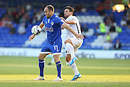 Lee Croft of Oldham Athletic holds off David Buchanan of Northampton Town during the EFL Sky Bet League 1 match between Oldham Athletic and Northampton Town at Boundary Park, Oldham, England on 16 August 2016. Photo by Simon Brady.