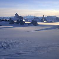 ANTARCTICA, Queen Maud Land. Fenris Mts., including (L to R) Ulvetanna, Kinntanna & Holtanna, rise above polar icecap.