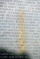 Jun 14, 2004; Washington DC, Washington, USA;  Washington Monument reflection off the stone of the Vietnam Veterans War Memorial inside Constituion Gardens. Names are in focus. Landmark travel location.